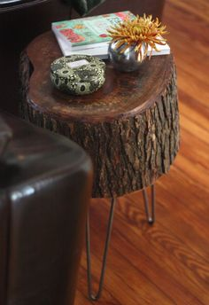 tree stumps would be cute to sit anything on. like a flower pot or something. a pile of books, a lamp.