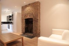 Completed project white painted brick fireplace Decorating Ideas Living Room Chimney Breast ~ Black Lake House living room with exposed brick chimney breast Design Ideas & Pictures Hello,. House, Home, Brick Chimney, Exposed Brick, House Styles, New Homes, Chimney Decor, Exposed Brick Fireplaces, Fireplace
