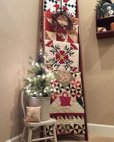 A quilt ladder that hubby built for me has some festive quilts on it. #24daysofchristmasfromourhousetoyours2016  check out @yellowfarmhouse @myrty50 @sfeigner @basketnut1 @cfander8