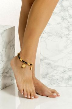 This is a slim leather anklet handmade with 24k gold or silver plated embellishments which means they don't tarnish with sun. It comes in two colors, black & natural tan. Wear it with cropped hemlines all summer long layered or solo. Greek Chic Handmades jewelry are designed and handcrafted in Athens, Greece from the best quality leather and nickel free hardware. Find your favs! Gold Anklet, Beaded Anklets, Gold Toe Rings, Hanging Beads, Ankle Chain, Leather Flip Flops, Anklet Bracelet, Bohemian Jewelry