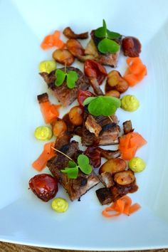 Grilled porkbelly confit beans, tomatoes, pickled carrorts and majo of sorrel