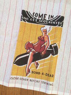 """Bomb A Dear"" pinup graphic from retro matchbook printed on cotton dishtowel.  vinpixstudios.com"