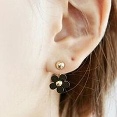 2 in 1 Earrings These cute black and gold earrings can be worn 2 ways. They can be worn with out without the flower. Zinc alloy metal. New in package. Jewelry Earrings