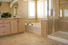 Beautiful work done with travertine and mosaics. Not a fan of the cabinets, though. I'm definately a fan of smaller, square shaped tiles on the bathroom floor. It seems to make the space feel bigger.