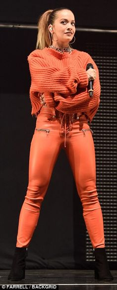 Stunning: The singer, 26, looked sensational as she slipped into a pair of skin-tight leather trousers for the gig
