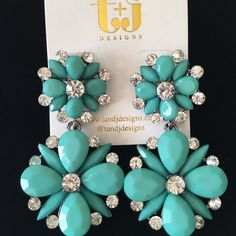 """T&J Designs Aqua Floral Drop Earrings T+J Designs Aqua Floral Drop Earrings with crystal accents    Materials: Resin, Base Metals &        Glass crystals  Nickel free & Lead free  Perfect for summer  Dimensions: 2.5"""" x 1.25""""  Post backed T&J Designs Jewelry Earrings"""