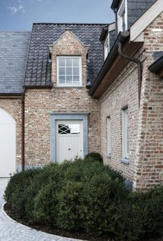 Dormers, love the door and brick w gray trim. Beautiful Home Gardens, Beautiful Homes, European Style Homes, Belgian Style, Mansions Homes, House Front, House Rooms, Architecture Details, Cottage