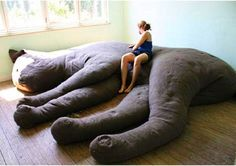 Giant Cat Couch. This isn't creepy at all.