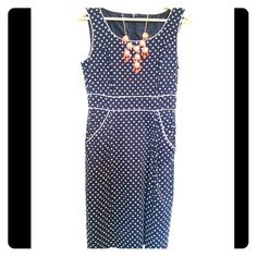 Tahari dress navy and white poka dots size 8 Blue and white poka dot shift dress in a size 8. This dress has a zip up the back and pockets!! Great for work, formal or play! Tahari Dresses Midi