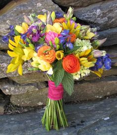 yellow, orange, blue and pink wildflower bouquet