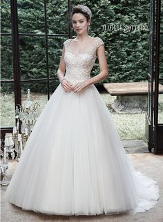 Romantic ball gown wedding dress, with lavish bead embroidered bodice and ethereal tulle skirt. Maloree by Maggie Sottero.