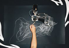 """Drawing Operations"" is an ongoing collaboration between New York-based artist Sougwen Chung and a robotic arm called Drawing Operations Unit: Generation 1, (D.O.U.G._1). Together the two draw in synchronized performance, with D.O.U.G. mimicking Chung's movements in real time using a … Continue reading →"