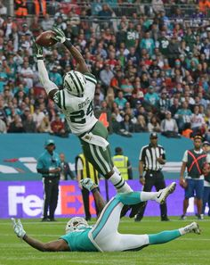 New York Jets' Darrelle Revis intercepts the ball during the NFL football game between the New York Jets and the Miami Dolphins and at Wembley stadium in London, Sunday, Oct. 4, 2015. (AP Photo/Tim Ireland)