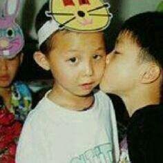 GD Jiyong G-DRAGON  who's the boy kissing him though? Haha!