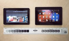 """Kindle left, PlayBook right.    Bezel on the PlayBook is about 3/8"""" larger than the Kindle Fire. Screen size is nearly identical (PlayBook is just a few millimeters larger).     http://www.azoda.vn"""