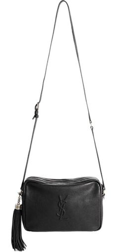This minimalist crossbody bag makes maximum impact with an embossed logo monogram and dramatic tassel embellishment.