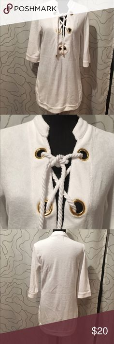 Victoria's Secret terry cloth coverup Like new white terry cloth swim coverup by Victoria Secret.2 side slits, 3/4 sleeves. Victoria's Secret Swim Coverups