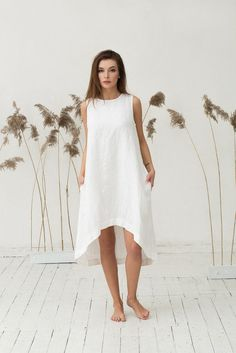 Handmade soft pure linen dress for women in off white (white with a shade of yellow, warm white) colour. Crafted from a softened middle weight linen fabric this contemporary dress is a must for this spring and summer. Roomy, breathable, perfect in the office or at the beach. The loose fit silhouette looks good on every shape. Please note that the model is 175 cm height. If you are shorter, the dress will be longer accordingly. Features: - sleeveless - knee length - two hidden side pockets…