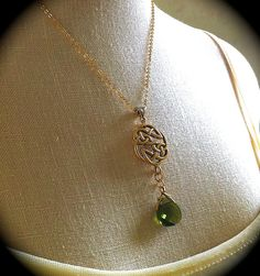 This is ridiculously perfect! https://www.etsy.com/listing/202560463/gold-celtic-knot-necklace-woodland-green