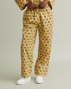 Elastic-waist cotton pants with side pockets and piped cuffs. Elastic waist with drawstring Side pockets Loose leg Cuff with piping Allover pattern inspired by Swedish carpet weaver Märta Måås-Fjetterström cotton Model is ft 9 in and is wearing a size XS