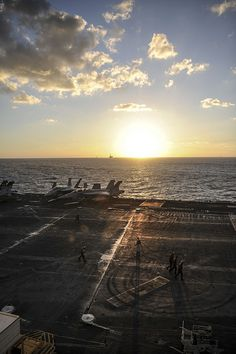 MEDITERRANEAN SEA (Oct. 20, 2013) Sailors walk across the flight deck of the aircraft carrier USS Nimitz (CVN 68). Nimitz is deployed supporting maritime security operations and theater security cooperation efforts in the U.S. 6th Fleet area of responsibility. (U.S. Navy photo by Mass Communication Specialist Seaman Siobhana R. McEwen/ Released)