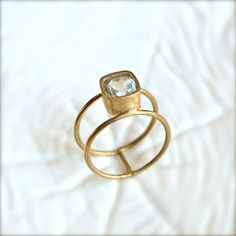 Double Wheel Gold Ring With Aquamarine Stone. $65.00, via Etsy.