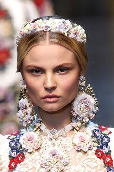 Hairpiece and earing detail as a model walks the runway at the Dolce & Gabbana Autumn/Winter 2012/2013 fashion show as part of Milan Womenswear Fashion Week on February 26, 2012 in Milan, Italy.