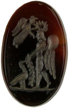 Roman Intaglio :    Ancient Roman carnelian intaglio, a winged Roman God receives a crown from Nike and a garland from a hawk.  100 AD
