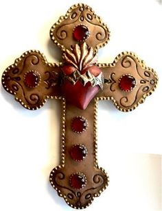 Tin Decorative Mano Wall Hanging from: Tin Flaming Corazon Picture Frame from: Tin Cross With Flaming Corazon and Glass Beads from: Corazon Liston Ornament from: Corazon Alas With Thorns Double Fla… Mexican Crafts, Mexican Folk Art, Crosses Decor, Wall Crosses, Jesus E Maria, Sign Of The Cross, Cross Art, Tin Art, Cross Crafts