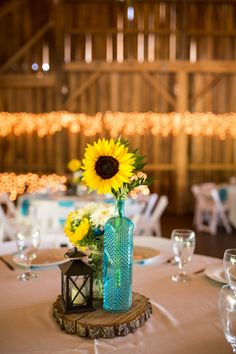 Rustic Floral Centerpiece| {Turquoise & Sunflowers} Rustic Wedding at Betsy's Barn|Photographer: Ctg Photography