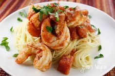 Angel Hair with Shrimp and Tomato Sauce Recipe Main Dishes with large shrimp, olive oil, garlic, white wine, diced tomatoes, half & half, oregano, salt, pepper, lemon juice, chopped parsley, angel hair