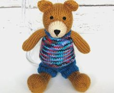 Hand knit teddy bear, ready to ship. Great baby shower gift for boy or girl. This children's stuffed animal plush makes a fun addition to the teddy bear and woodland nursery. Facial features are hand embroidered and child friendly. Clothing slips off and on easily, no buttons or fasteners. Premium non-allergic polyfil gives this cute stuffed toy a nice squishy and huggable shape. Bear stands 13 inches (33 cm) tall from head to toe, including ears. verycarey.etsy.com