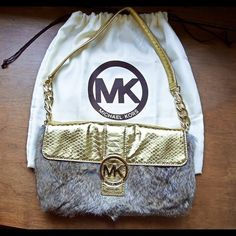 Authentic Michael Kors Rabbit Fur Bag This unique Michael Kors bag is gently used but in like new condition. Includes the MK dust bag. Made of genuine rabbit fur & leather molded to portray a gold snakeskin look. The strap is short and when thrown over the shoulder it hangs perfectly. Small kink in the strap as seen in the picture just from having it hung (should come out once layed flat).  ask me anything! Michael Kors Bags Shoulder Bags
