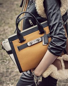 Our most-wanted Coach Swagger bag is updated in rich leathers with graphic contrast for fall. We love the adjustable leather strap and distinctive topstitching detail.