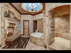 Painted round try ceiling with chandelier over tub, walk in shower  3206 NW 206th St, Edmond, OK 73012 | Zillow