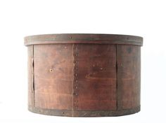 This is a beautiful, antique, bentwood, metal band and wooden grain measure. It has really cool, metal bands on the sides that wrap around the bottom. This is a really large, bentwood measure that is 14 1/4 across and 8 3/4 high. It is marked on the inside with a stamp that reads