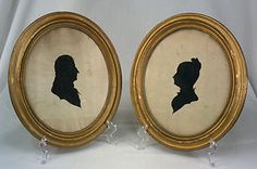 A pair of 19th Century Antique Silhouette Portraits.  A pair of hollow-cut silhouettes in matching frames that measure, presumably man and wife.   Backing for female appears to be a censes report from the day - very interesting.