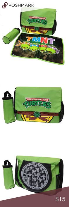 """Teenage Mutant Ninja Turtles Diaper Bag tmnt diaper bag is perfect for fans of the popular characters super-colorful design on bright green background roomy main compartment mesh side pockets bag includes: adjustable shoulder strap velcro front closure nylon cover measures 12.5"""" l x 16.5"""" w x 2"""" d imported removable burp cloth """"cape"""" changing pad insulated bottle holder Nickelodeon Accessories Bags"""