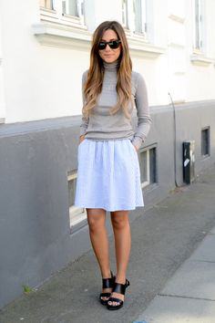 Michelle Nielsen is wearing grey turtleneck from FrontRow, striped skirt from Monki and shoes from  Other Stories