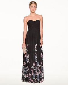 Robe bustier fleurie en mousseline - Une profusion de fleurs agrémente le bas de cette robe longue en mousseline, créant un effet de toute beauté.
