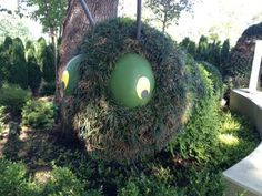 A caterpillar-shaped topiary serves as the entrance to a maze for toddlers in the First Adventure area at the Dallas Arboretum's Rory Meyers Children's Adventure Garden.