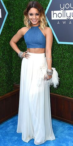 VANESSA HUDGENS Vanessa attends the Young Hollywood Awards in L.A. rocking her signature boho style: a denim crop top, a white floor-length skirt, a plume-covered clutch and more bangles than we can count.