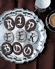 These ghostly greetings appear atop delicate chocolate  cookies with the help of confectioners' sugar. Our Gothic letter templates (below) help you spell out messages for visiting goblins.