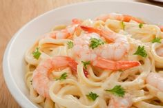 200 calorie Shrimp Fettuccine Alfredo.  The secret is- Shirataki noodles!  If you can find these noodles (in the refrigerator section w tofu and stuff) give em a try.  Good substitute for noodles in any recipe if you're trying to cut carbs! (they're made from a plant root).