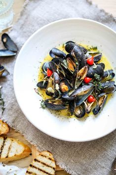 Steamed Mussels with buttery saffron sauce |          3-4 lbs. small mussels, cleaned & debearded     6 oz. butter (preferable Gluten Free butter, i.e. 'earth balance')     2-3 shallots, finely chopped     2-3 cloves garlic, finely chopped     a few springs of thyme     1/4 cup Dijon mustard (preferable Gluten Free, i.e. 'Annie's Naturals')     1 cup dry white wine, such as sauvignon blanc     1 cup fish stock     a pinch of saffron threads     salt & pepper, to taste (if needed)