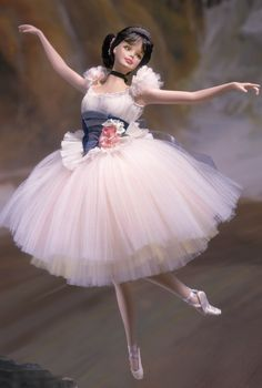 Inspired by the paintings of Edgar Degas, Barbie® is a beautiful ballerina made of fine bisque porcelain.