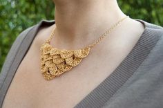 Someday I need to learn how to crochet, if only so that I can make this fabulous necklace. :)