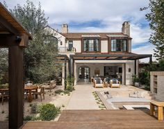 Tour a transitional Southern California home with charming French style California Homes, Southern California, Wood Trellis, French Style Homes, Outdoor Seating Areas, Exterior Doors, Outdoor Living, Indoor Outdoor, My Dream Home