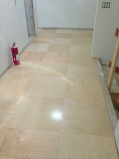 ply wood flooring ideas | ... hall received a simple floor of maple-veneer plywood cut into tiles