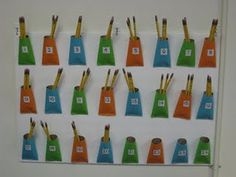 pencil pockets for each kid - make out of toilet paper tubes! genius!